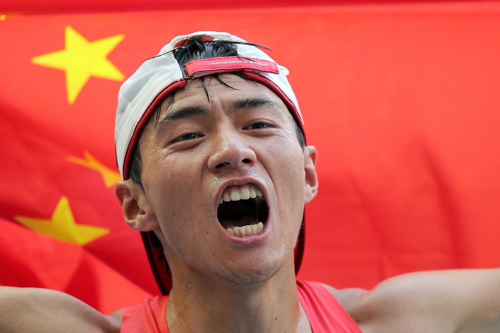 . Ding Chen of China celebrates winning silver in the Men\'s 20km Race Walk final during Day Two of the 14th IAAF World Athletics Championships Moscow 2013 at Luzhniki Stadium on August 11, 2013 in Moscow, Russia.  (Photo by Ian Walton/Getty Images)