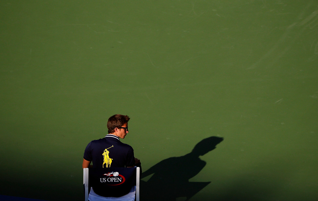 . A line judge waits for Jiri Vesely, of the Czech Republic, to serve against Stan Wawrinka, of Switzerland, during the opening round of the 2014 U.S. Open tennis tournament, Monday, Aug. 25, 2014, in New York. (AP Photo/Elise Amendola)
