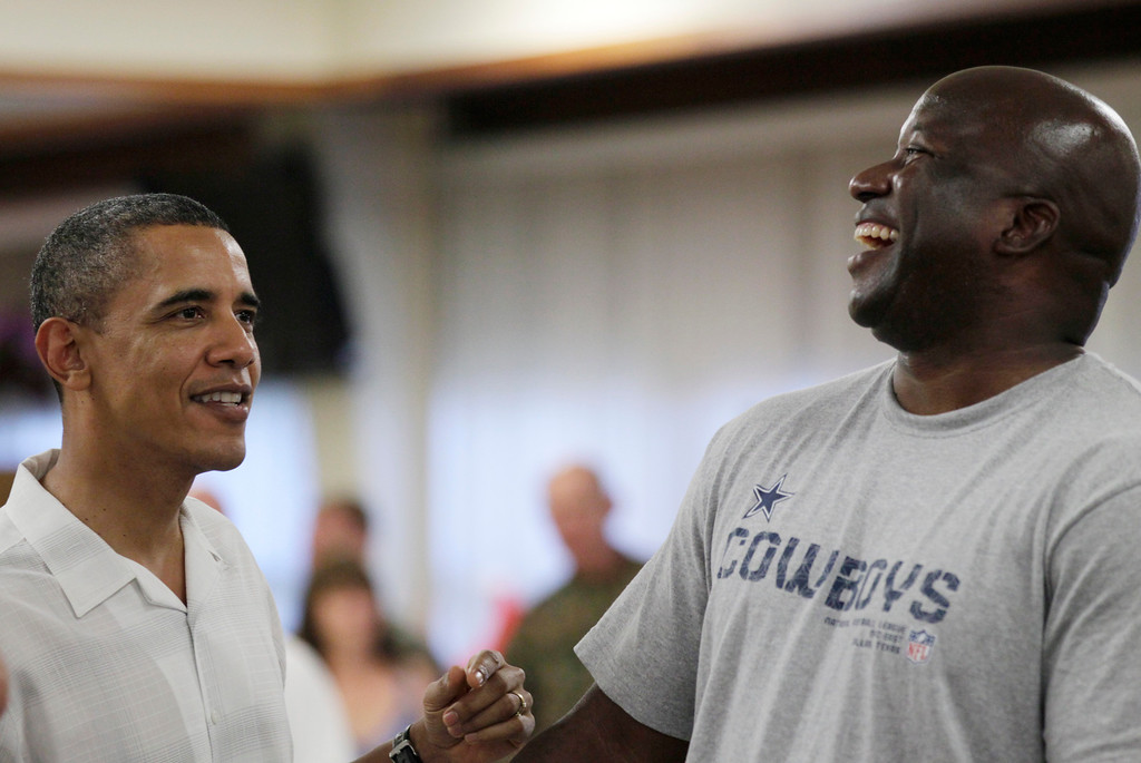 . President Barack Obama laughs with a member of the military during Christmas dinner at Anderson Hall on Marine Corps Base Hawaii in Kaneohe, Hawaii, Saturday, Dec. 25, 2010. The first family was in Hawaii for the holidays. (AP Photo/Carolyn Kaster)