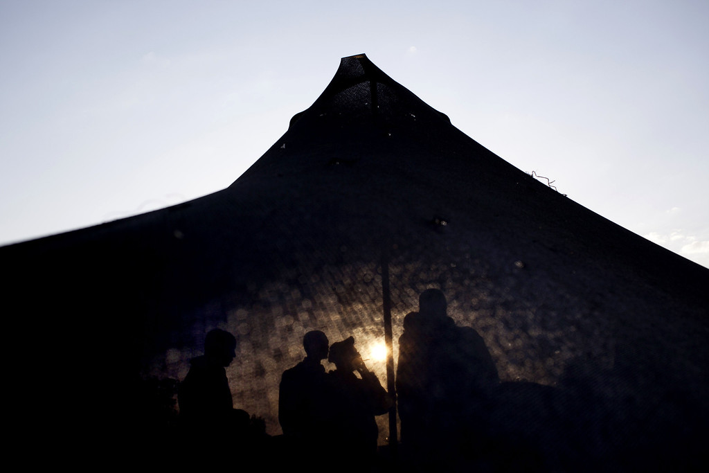 . Israeli soldiers of the Golani brigade gather in a tent, as the sun rises, before a military exercise in the Israeli controlled Golan Heights, near the border with Syria, Tuesday, May 7, 2013. (AP Photo/Ariel Schalit)