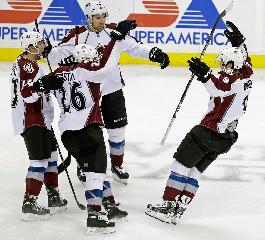 . Colorado Avalanche\'s Matt Duchene, right, skates in to celebrate his game-winning shootout goal against the Minnesota Wild in an NHL hockey game on Thursday, Feb. 14, 2013, in St. Paul, Minn. Duchene also scored in the third period in their 4-3 win. (AP Photo/Jim Mone)