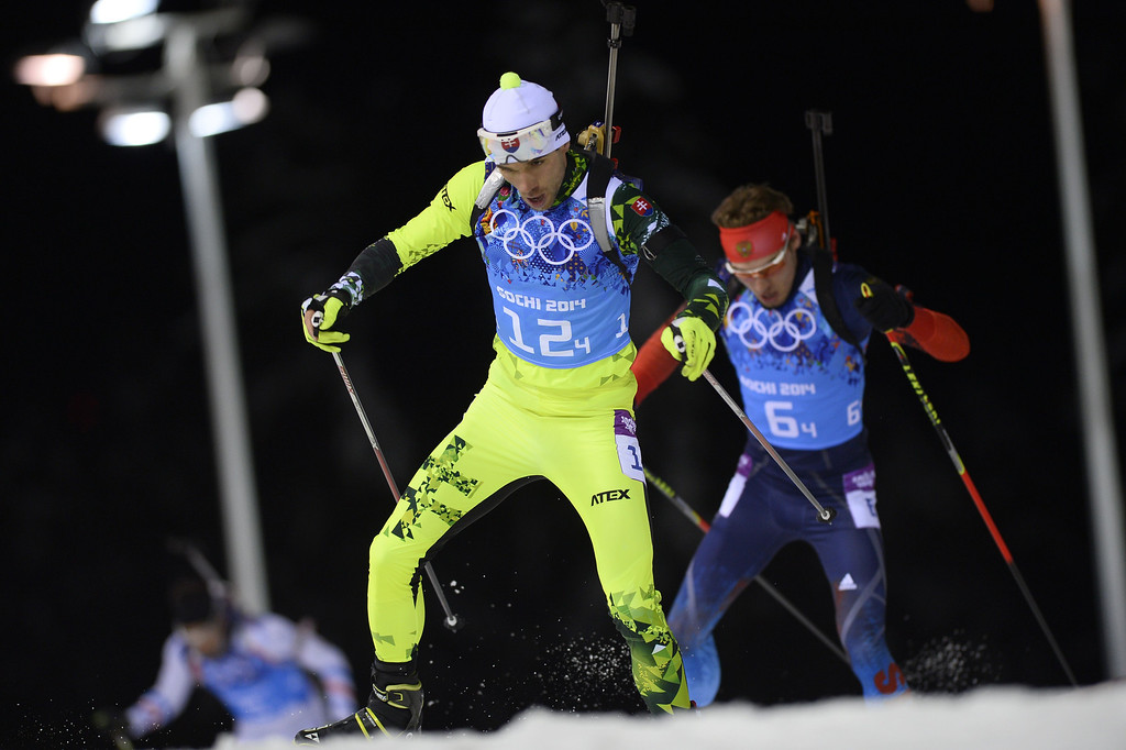 . Slovakia\'s Matej Kazar and Russia\'s Anton Shipulin compete in the Biathlon mixed 2x6 km + 2x7,5 km Relay at the Laura Cross-Country Ski and Biathlon Center during the Sochi Winter Olympics on February 19, 2014 in Rosa Khutor near Sochi.  AFP PHOTO / PIERRE-PHILIPPE  MARCOU/AFP/Getty Images