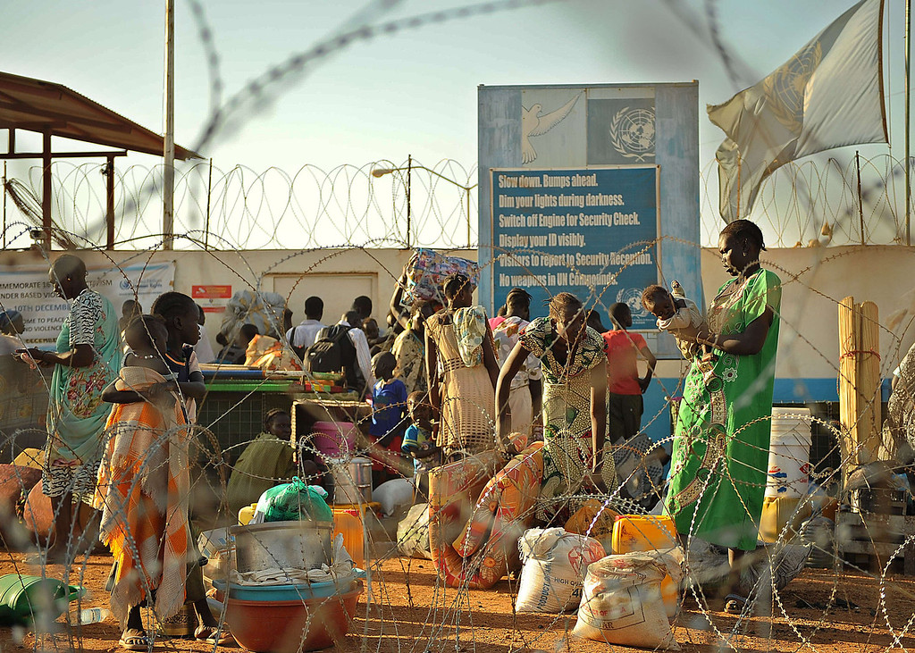. Residents of Juba arrive at the UN compound on December 20, 2013 where they sought shelter. African diplomats made a push for peace in South Sudan on Friday as bitter fighting spread across the world\'s youngest nation, with US President Barack Obama warning the oil-rich state was on the brink of civil war. The United Nations Security Council readied emergency consultations on the crisis amid fears that fighting between rival army factions, which has already claimed hundreds of lives and sent tens of thousands seeking UN protection, could escalate. TONY KARUMBA/AFP/Getty Images