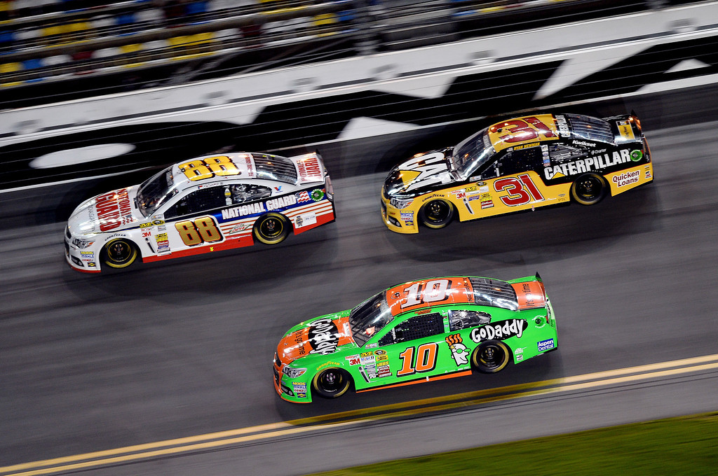 . Danica Patrick, driver of the #10 GoDaddy Chevrolet, races Dale Earnhardt Jr., driver of the #88 National Guard Chevrolet, and Ryan Newman, driver of the #31 Caterpillar Chevrolet, during the NASCAR Sprint Cup Series Budweiser Duel 1 at Daytona International Speedway on February 20, 2014 in Daytona Beach, Florida.  (Photo by Jared C. Tilton/Getty Images)