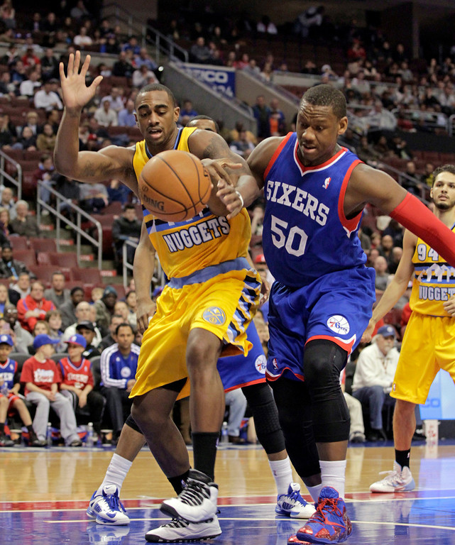 . Denver Nuggets\' Darrell Arthur (00),  and Philadelphia 76ers\' Lavoy Allen (50) chase a loose ball in the first half of an NBA basketball game Saturday Dec. 7, 2013, in Philadelphia.  (AP Photo/H. Rumph Jr)