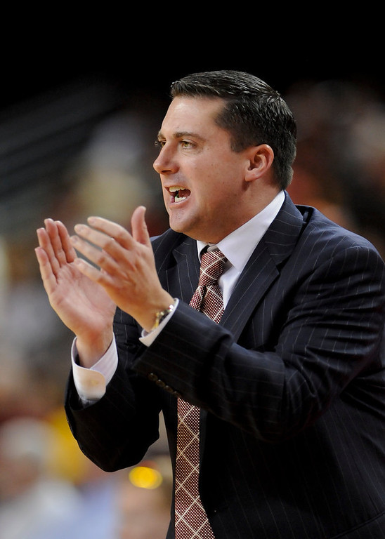 . Southern Cal interim head coach Bob Cantu yells his player on during the first half of an NCAA college basketball game against Oregon State, Saturday, Jan. 19, 2013, in Los Angeles. (AP Photo/Gus Ruelas)