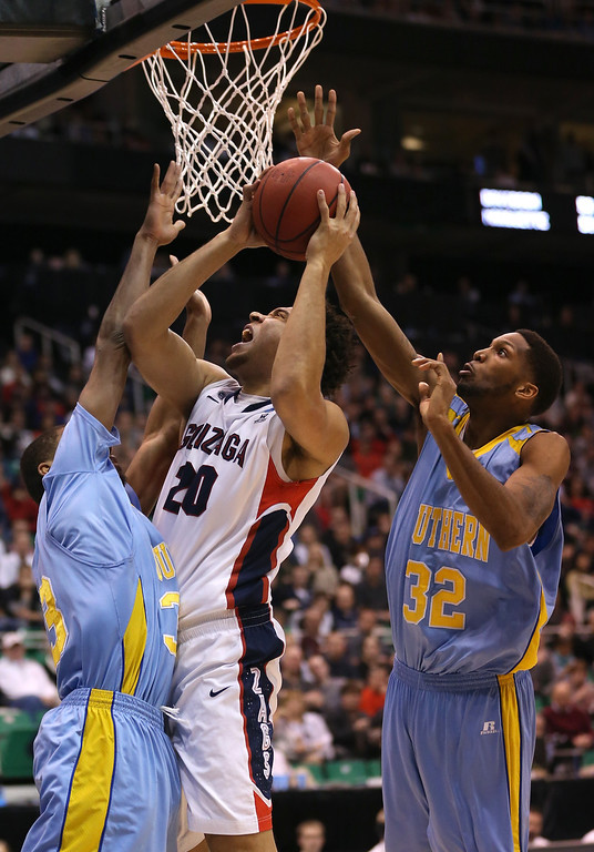 . SALT LAKE CITY, UT - MARCH 21:  Elias Harris #20 of the Gonzaga Bulldogs goes up for a shot against Malcolm Miller #33 and Brandon Moore #32 of the Southern University Jaguars in the second half during the second round of the 2013 NCAA Men\'s Basketball Tournament at EnergySolutions Arena on March 21, 2013 in Salt Lake City, Utah.  (Photo by Streeter Lecka/Getty Images)