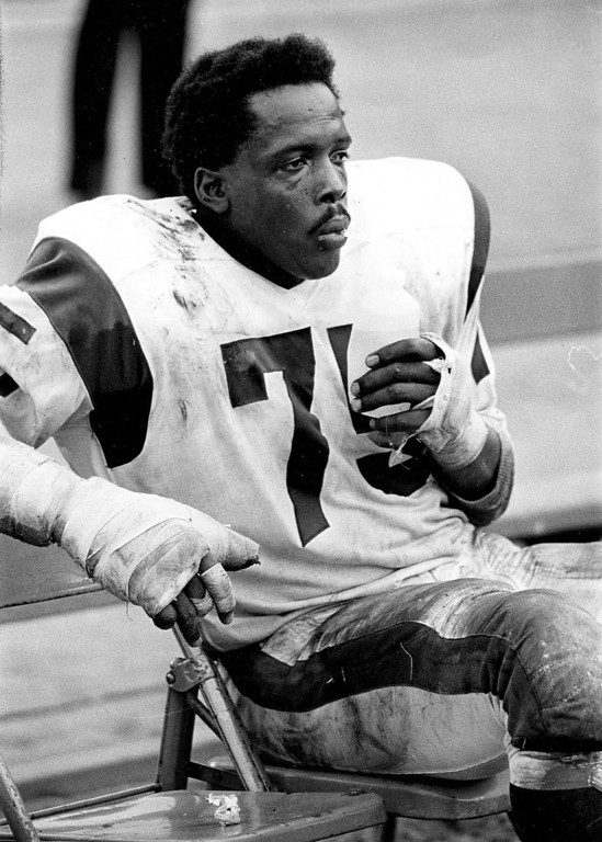 """. In this Nov. 3, 1968 photo provided by NFL Photos, Hall of Fame defensive end David \""""Deacon\"""" Jones (75) of the Los Angeles Rams sits during the Rams 10-7 victory over the Detroit Lions in Los Angeles. (AP Photo/NFL Photos)"""