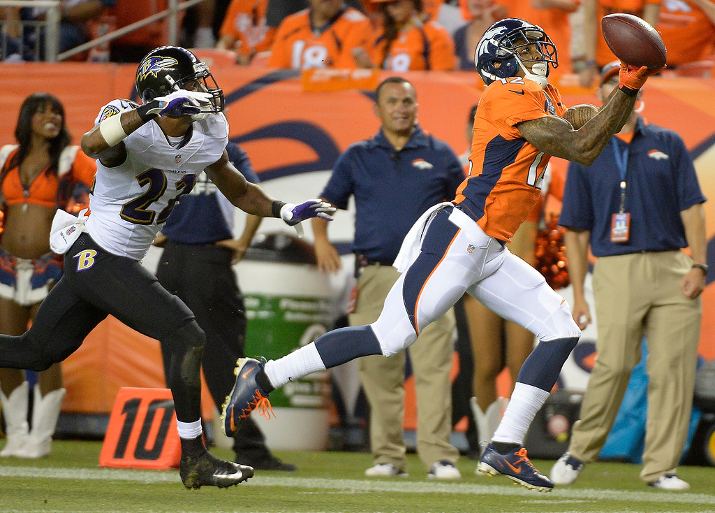 . Denver Broncos wide receiver Andre Caldwell (12) makes a catch for a touchdown to open the third quarter.   (Photo by John Leyba/The Denver Post)