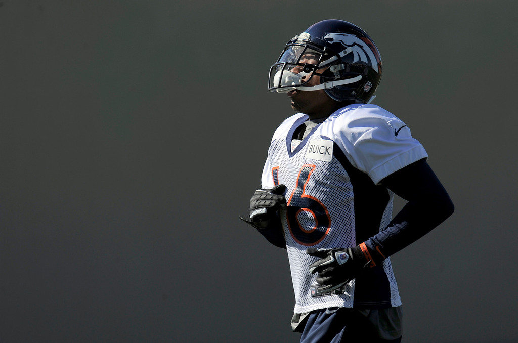 . Denver Broncos Chris Harris (25) works on drills during practice on October 30, 2013 at Dove Valley. The players swapped jerseys for Halloween. (Photo by John Leyba/The Denver Post)