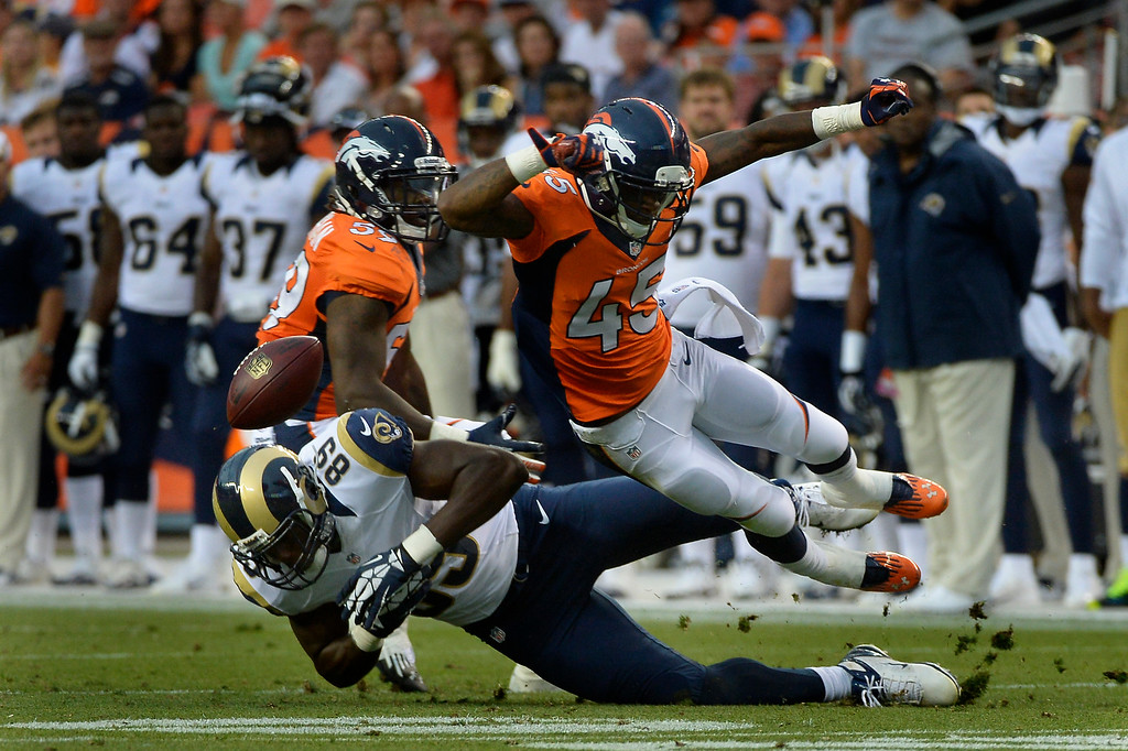 . DENVER, CO. - August 24: Cornerback Dominique Rodgers-Cromartie (45) of the Denver Broncos blasts tight end Jared Cook (89) of the St. Louis Rams to knock the ball loose during the 3rd pre-season game of the season at Sports Authority Field at Mile High. August 24, 2013 Denver, Colorado. (Photo By Joe Amon/The Denver Post)