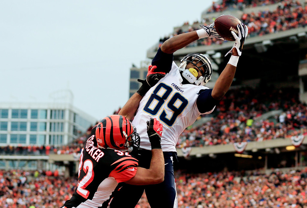 . Tight end Ladarius Green #89 of the San Diego Chargers catches a touchdown in the third quarter as defensive back Chris Crocker #32 of the Cincinnati Bengals defends during a Wild Card Playoff game at Paul Brown Stadium on January 5, 2014 in Cincinnati, Ohio.  (Photo by Rob Carr/Getty Images)