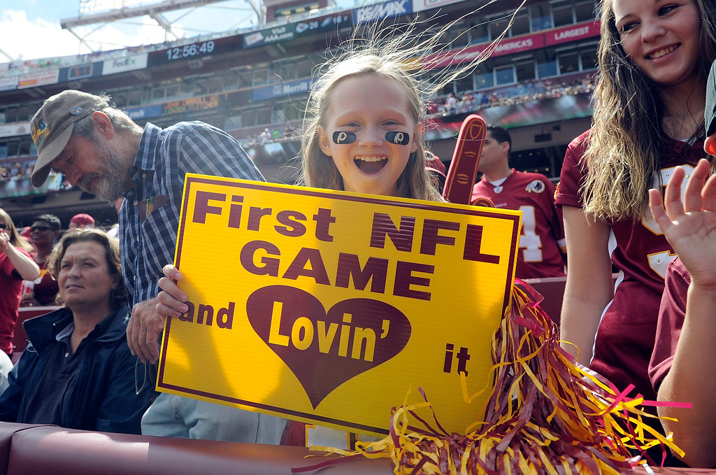 . LANDOVER, MD - SEPTEMBER 22:  A young fan cheers at the start of the game between the Washington Redskins and the Detroit Lions at FedExField on September 22, 2013 in Landover, Maryland.  (Photo by Greg Fiume/Getty Images)