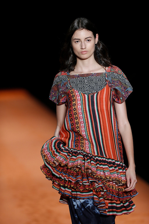 . A model wears a creation from the Oh Boy collection during Fashion Week in Rio de Janeiro, Brazil, Wednesday, April 9, 2014. (AP Photo/Silvia Izquierdo)