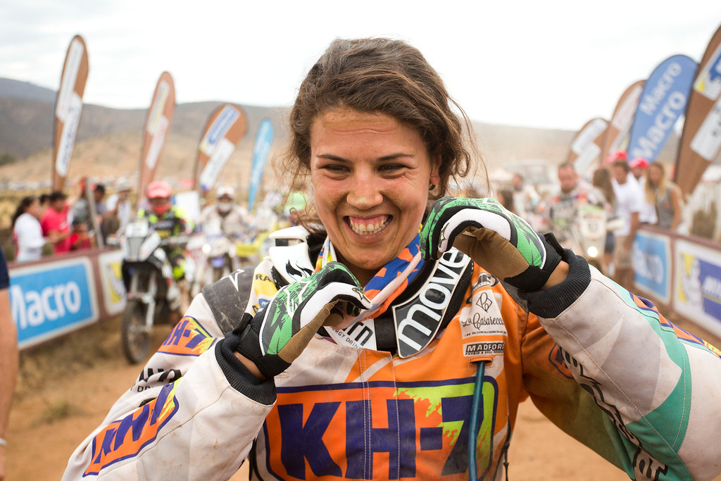 . Honda rider Laila Sanz, from Spain, arrives at the end of the special stage, part of the final 13th stage of the Dakar Rally in Illapel, Chile, Saturday, Jan. 18, 2014. Sanz finished 16th in the bike category. (AP Photo/Victor R. Caivano)