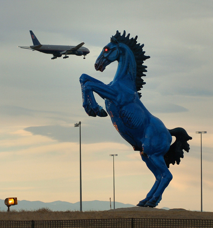 ". A 32-foot sculpture commissioned three years before Denver International Airport opened was finally installed  in the median of Pena Boulevard leading up to the terminal.  ""Mustang\"" was bolted onto a concrete base.  Creation of the sculpture survived lawsuits over the pace of the work, the illness of sculptor Luis Jimenez, and his death when a section of the sculpture came loose from a hoist and pinned him against a steel support beam.  Jimenez was 65 when he died at his Hondo, N.M., studio in June 2006. His family, including sons Adan and Orion, finished the sculpture, his widow Susan Jimenez said.  Helen H. Richardson/The Denver Post"