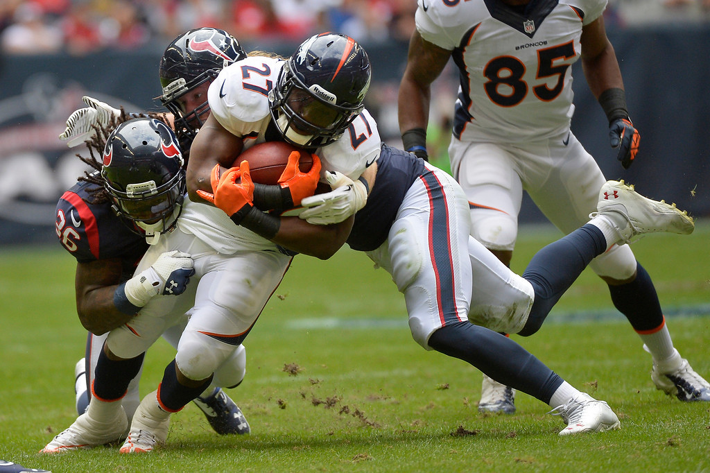 . Running back Knowshon Moreno #27 of the Denver Broncos picks up yards against the Houston Texans at Reliant Stadium December 22, 2013 Houston, Texas. (Photo By Joe Amon/The Denver Post)