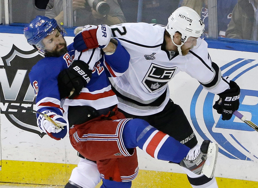 . New York Rangers right wing Martin St. Louis (26), left, collides with Los Angeles Kings center Trevor Lewis (22) in the second period during Game 3 of the NHL hockey Stanley Cup Final, Monday, June 9, 2014, in New York. (AP Photo/Frank Franklin II)