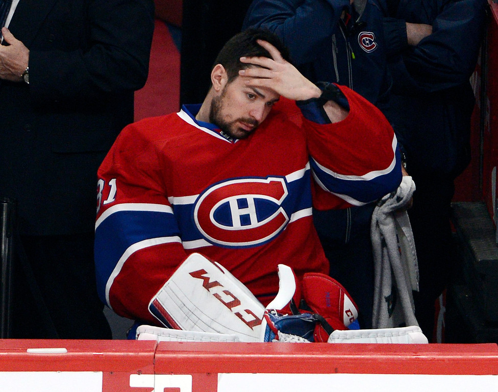 . Montreal Canadiens goalie Carey Price (31) watches from the bench during the third period in Game 1 of the Eastern Conference finals in the NHL hockey Stanley Cup playoffs in Montreal on Saturday, May 17, 2014. The Rangers won 7-2. (AP Photo/The Canadian Press, Ryan Remiorz)