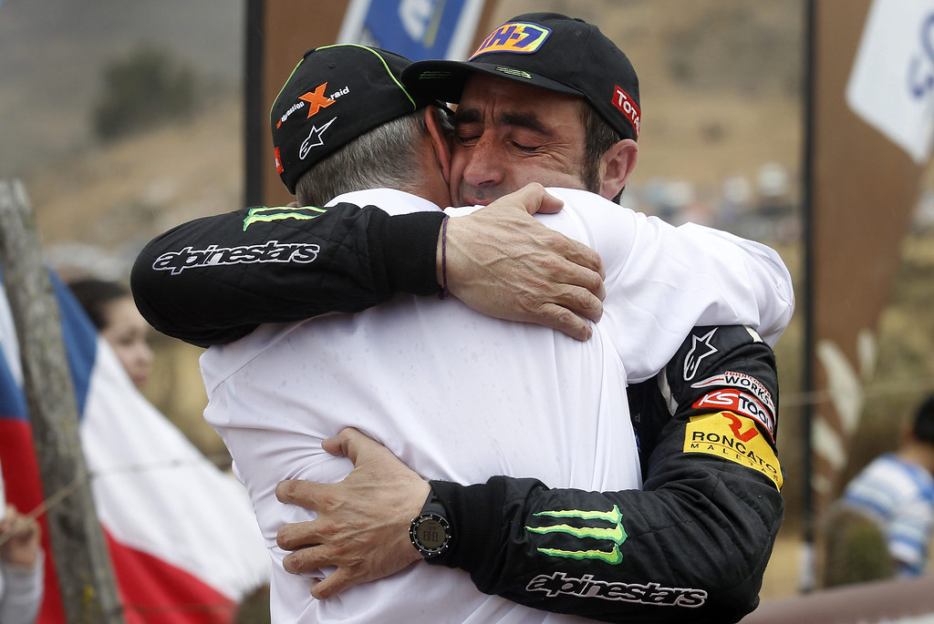 . Spanish Nani Roma (R) hughs X-Team owner, Sven Quandt, after arriving to the finish line of the last stage of Rally Dakar 2014 at Illapel locality, 150 km from Valparaiso, Chile, 18 January 2014. The rally takes place in Argentina, Bolivia and Chile from 04 to 18 January 2014.  EPA/FELIPE TRUEBA