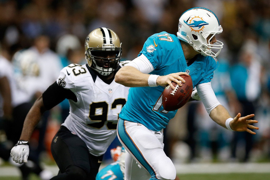 . Ryan Tannehill #17 of the Miami Dolphins is sacked by  Junior Galette #93 of the New Orleans Saints at the Mercedes-Benz Superdome on September 30, 2013 in New Orleans, Louisiana.  (Photo by Chris Graythen/Getty Images)