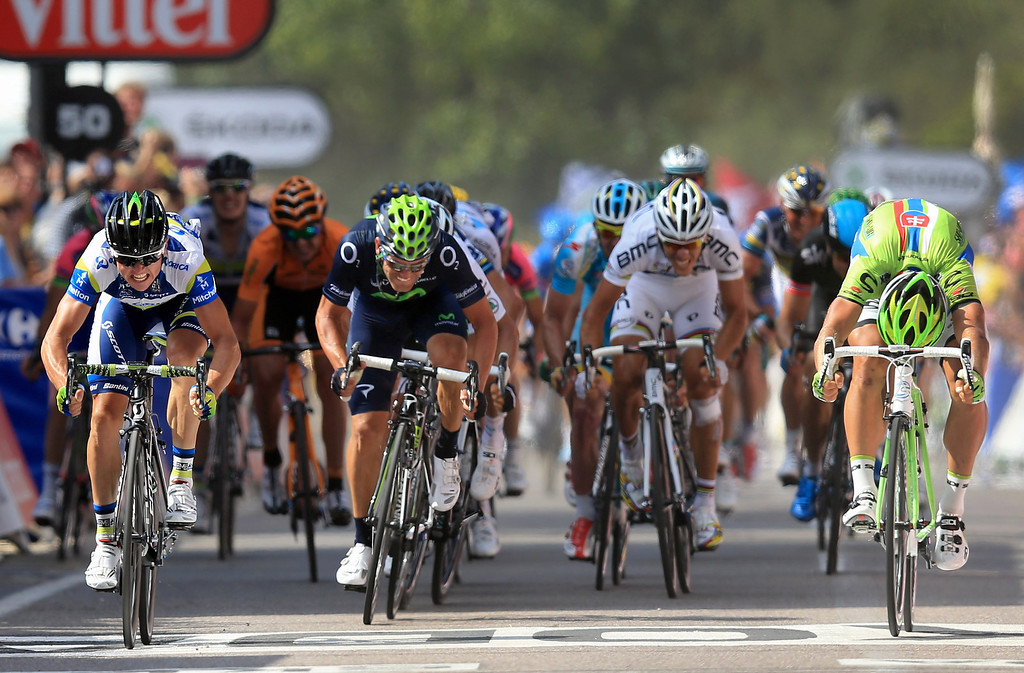 . Simon Gerrans (L) of Australia riding for Orica GreenEdge takes the win as he out sprints Peter Sagan (R) of Slovakia riding for Cannondale in second place in stage three of the 2013 Tour de France, a 145.5KM road stage from Ajaccio to Calvi, on July 1, 2013 in Calvi, France. The 100th edition of Le Tour de France commences on the island of Corsica and ends July 21 in Paris.  (Photo by Doug Pensinger/Getty Images)
