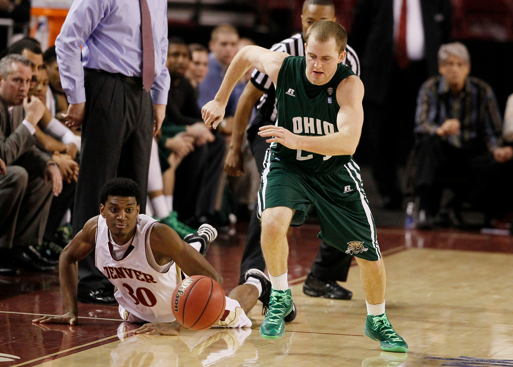 . Ohio guard Travis Wilkins, right, pursues a loose ball with Denver guard Cam Griffin in the second half of Denver\'s 61-57 victory in a first-round NIT college basketball  in Denver on Tuesday, March 19, 2013. (AP Photo/David Zalubowski)