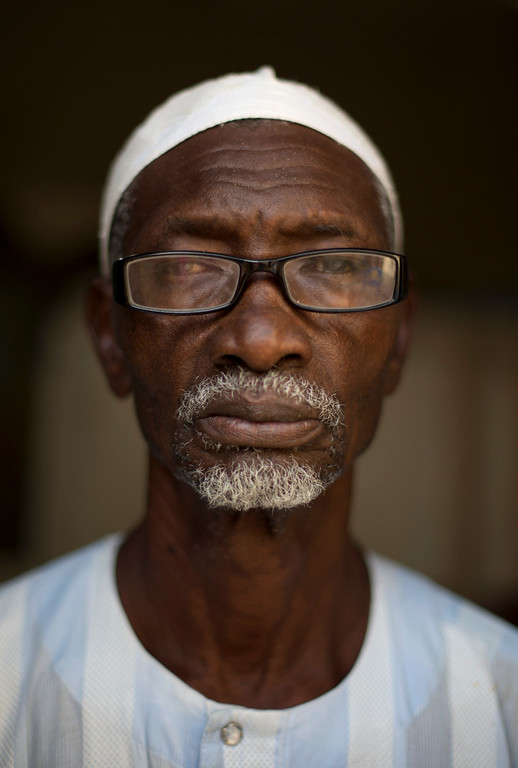 ". Amadou Mbaye, 74, poses for a portrait in Dakar, Senegal on Sunday, Sept. 1, 2013. When asked what his greatest fear was as he grew older, Mbaye replied that his only concern was for the future of the younger generation. ""Since God allowed me to live to 74, I can only thank him. I am really satisfied. I am concerned for the young children, and I am really worried for their future. Life is too expensive, there is too much unemployment, their health is precarious.\"" In response to the question of what is the greatest problem facing the elderly in Senegal, Mbaye responded that poor economic conditions make the financial situation of the elderly more unpredictable than in the past, when they could count on their children to support them. \""Senegal is a poor country. There is no employment for the young to allow them to care for the elderly, and we no longer have the strength to work to support the household.\"" (AP Photo/Rebecca Blackwell)"