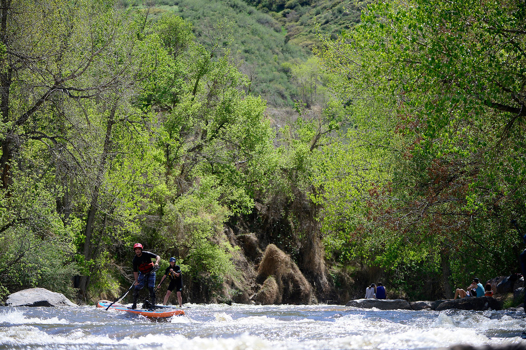 . Peter Hall rides the water during Golden Games at the Clear Creek Whitewater Park. (Photo by AAron Ontiveroz/The Denver Post)