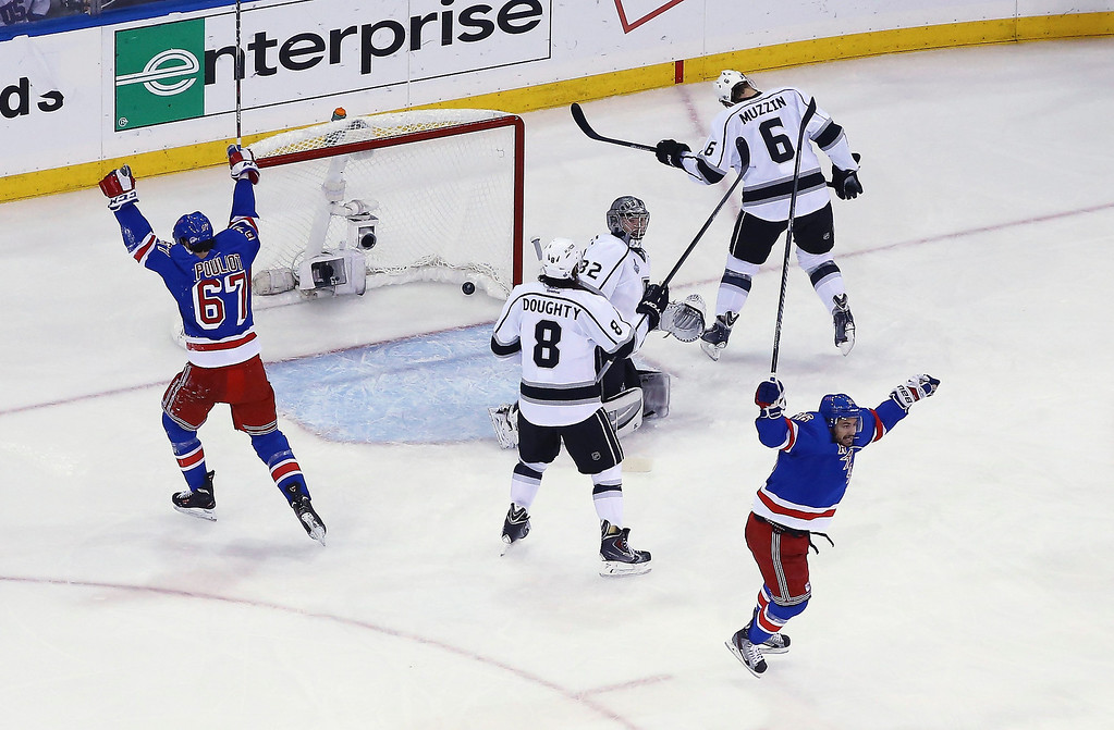 . Benoit Pouliot #67 of the New York Rangers celebrates his goal on Jonathan Quick #32 of the Los Angeles Kings during the first period of Game Four of the 2014 NHL Stanley Cup Final at Madison Square Garden on June 11, 2014 in New York, New York.  (Photo by Al Bello/Getty Images)