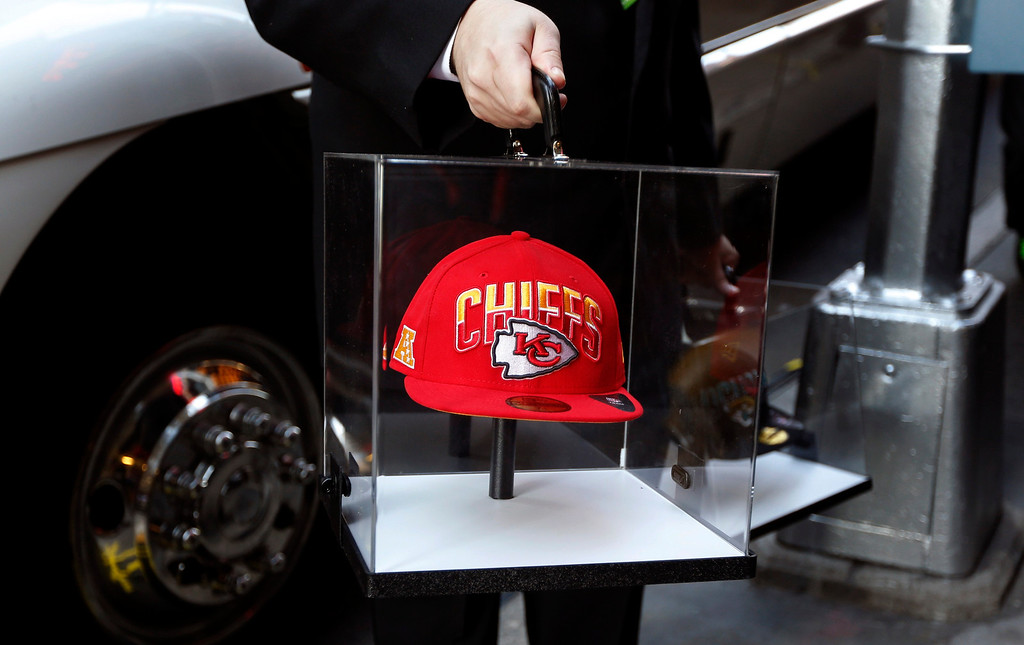 . An official carries a Kansas City Chiefs cap in a glass case into New York\'s Radio City Music Hall, before the start of the 2013 NFL Draft, April 25, 2013. The Chiefs have the first overall pick in the National Football League (NFL) Draft, which kicks off with first-round selections on Thursday.    REUTERS/Shannon Stapleton
