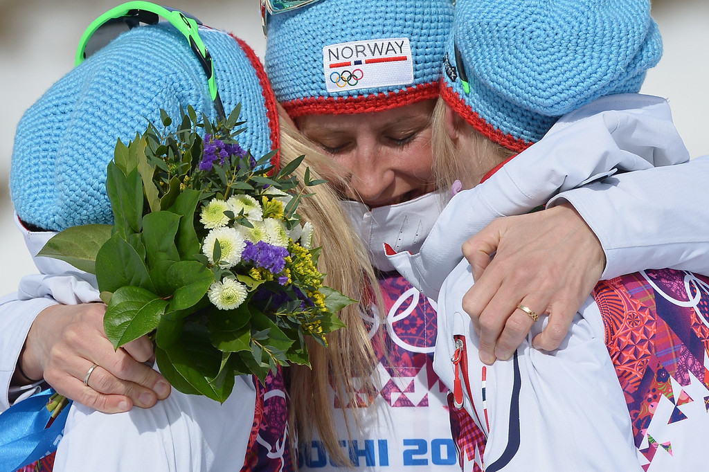 . From left: silver medalist Norway\'s Therese Johaug, gold medalist Norway\'s Marit Bjoergen and bronze medalist Norway\'s Kristin Stoermer Steira celebrate at the podium in the Women\'s Cross-Country Skiing 30km Mass Start Free Flower Ceremony at the Laura Cross-Country Ski and Biathlon Center during the Sochi Winter Olympics on February 22, 2014, in Rosa Khutor, near Sochi. ALBERTO PIZZOLI/AFP/Getty Images
