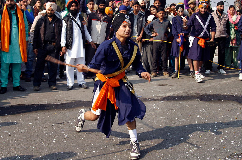 . A Sikh warrior displays martial art skills during a procession taken out ahead of the birth anniversary of Guru Gobind Singh in Jammu, India, Saturday, Jan. 4, 2014. The birth anniversary of Guru Gobind Singh, the tenth Sikh guru, will be marked on Jan. 7 this year. (AP Photo/Channi Anand)