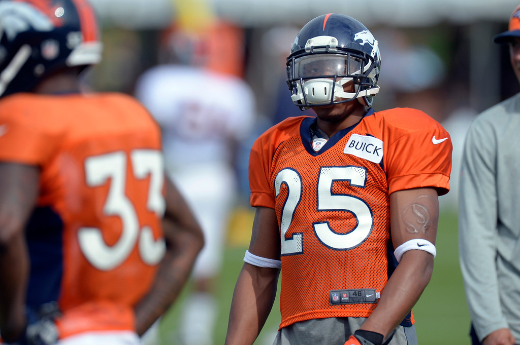 . Denver Broncos CB Chris Harris (25) runs through drills during training camp August 1, 2013 at Dove Valley. (Photo By John Leyba/The Denver Post)