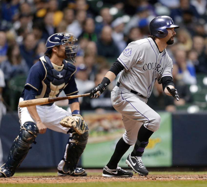 . Colorado Rockies\' Todd Helton watches his RBI single against the Milwaukee Brewers during the seventh inning of a baseball game Tuesday, April 2, 2013, in Milwaukee. (AP Photo/Jeffrey Phelps)