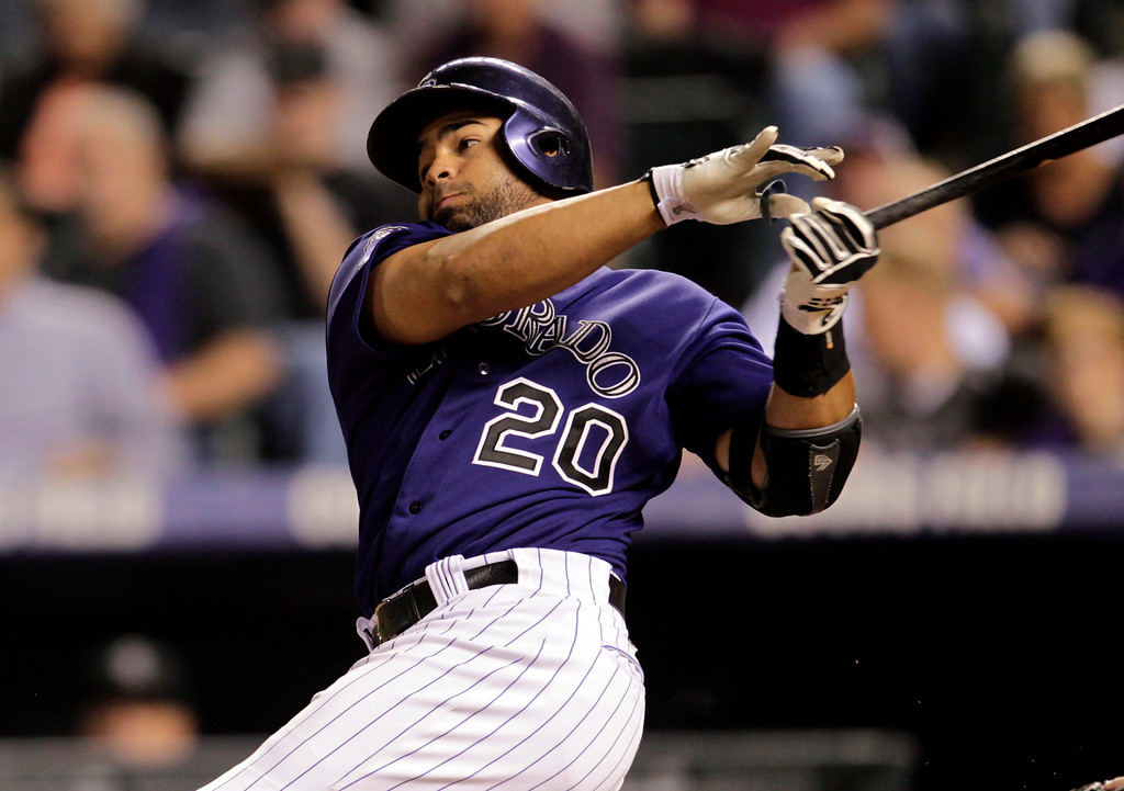 . Colorado Rockies\' Wilin Rosario hits a double against the St. Louis Cardinals during the seventh inning of a baseball game in Denver on Monday, Setp. 16, 2013.(AP Photo/Joe Mahoney)