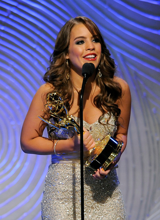 ". Kristen Alderson accepts the award for outstanding younger actress in a drama series for ""General Hospital\"" at the 40th Annual Daytime Emmy Awards on Sunday, June 16, 2013, in Beverly Hills, Calif. (Photo by Chris Pizzello/Invision/AP)"