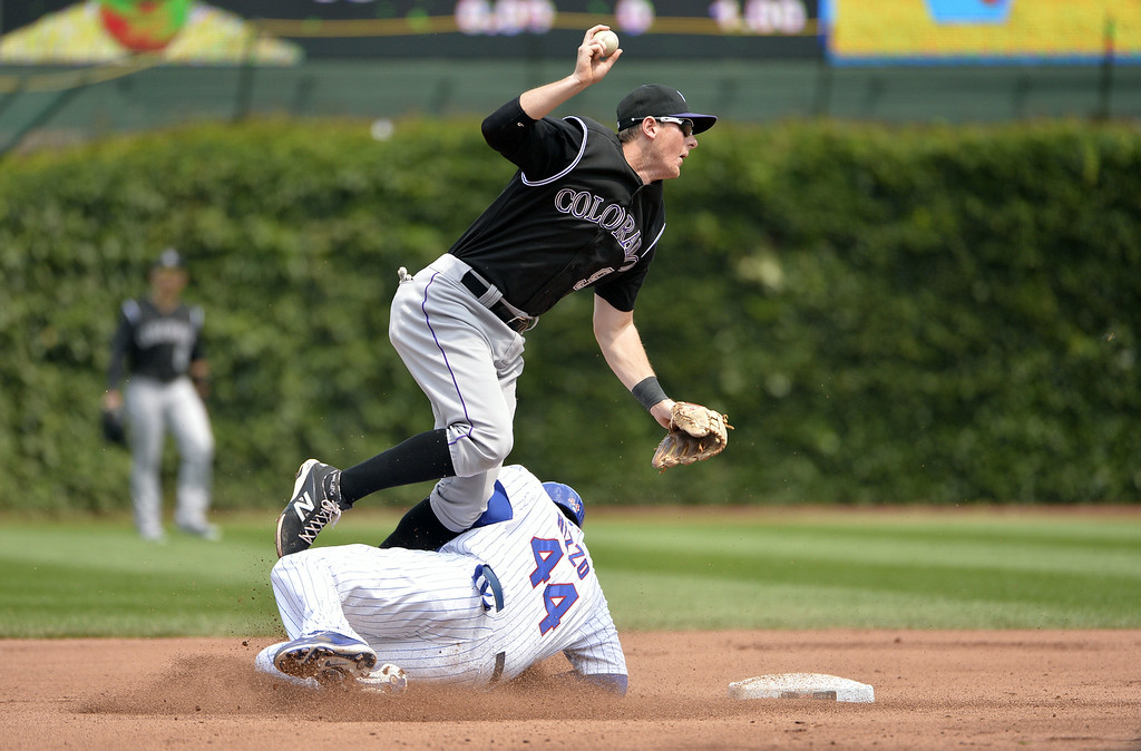 . Anthony Rizzo #44 of the Chicago Cubs slides into second baseman D.J. LeMahieu #9 of the Colorado Rockies to break up a double play on a ground ball hit by Starlin Castro during the fourth inning at Wrigley Field on July 31, 2014 in Chicago, Illinois.  (Photo by Brian Kersey/Getty Images)