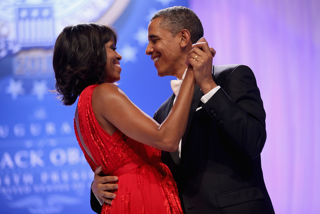 . WASHINGTON, DC - JANUARY 21:  U.S. President Barack Obama and first lady Michelle Obama dance together during the Comander-in-Chief\'s Inaugural Ball at the Walter Washington Convention Center January 21, 2013 in Washington, DC. Obama was sworn-in for his second term of office earlier in the day.  (Photo by Chip Somodevilla/Getty Images)
