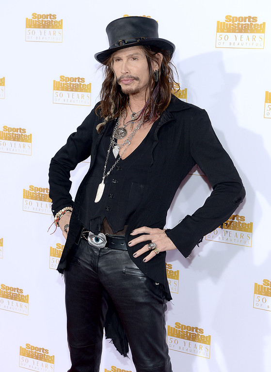 . Musician Steven Tyler of Aerosmith attends NBC and Time Inc. celebrate the 50th anniversary of the Sports Illustrated Swimsuit Issue at Dolby Theatre on January 14, 2014 in Hollywood, California.  (Photo by Dimitrios Kambouris/Getty Images)