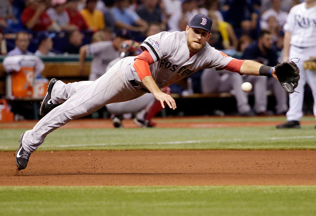 . Boston Red Sox\'s third baseman Will Middlebrooks dives for the ball off a single by Tampa Bay Rays\' Ben Zobrist in the seventh inning in Game 3 of an American League baseball division series, Monday, Oct. 7, 2013, in St. Petersburg, Fla. (AP Photo/Chris O\'Meara)