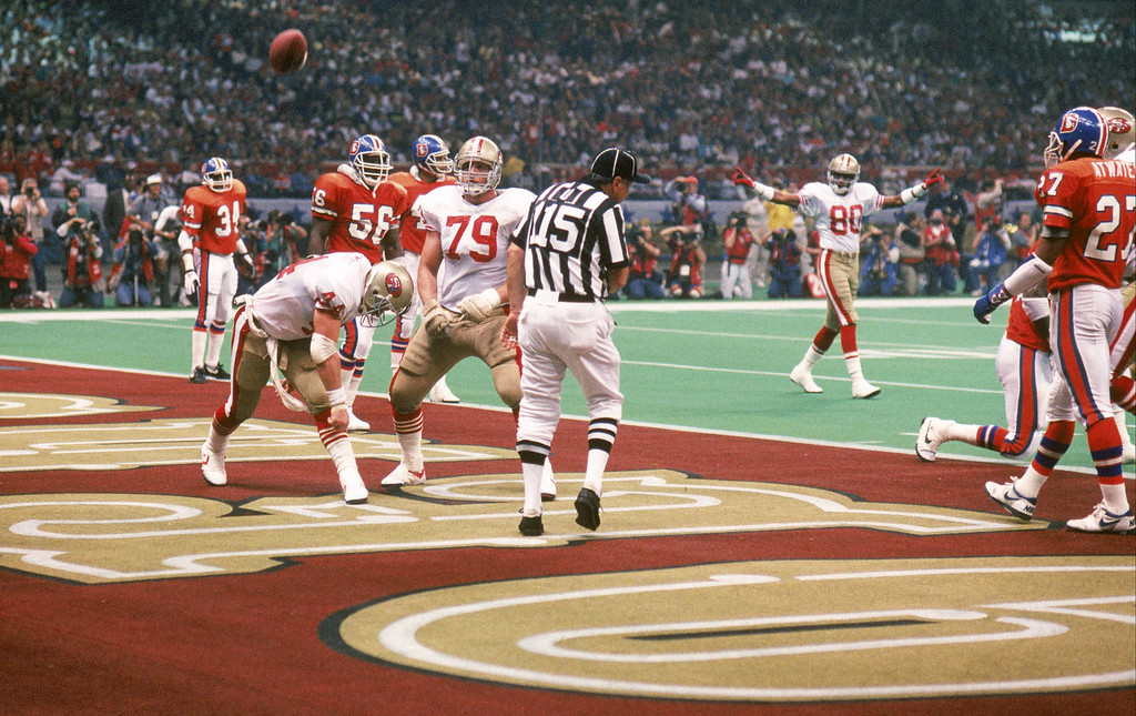 . Full back Tom Rathman #44 of the San Francisco 49ers spikes the ball after scoring a touchdown in Super Bowl XXIV against the Denver Broncos at Louisiana Superdome on January 28, 1990 in New Orleans, Louisiana.  The 49ers won 55-10.  (Photo by George Rose/Getty Images)