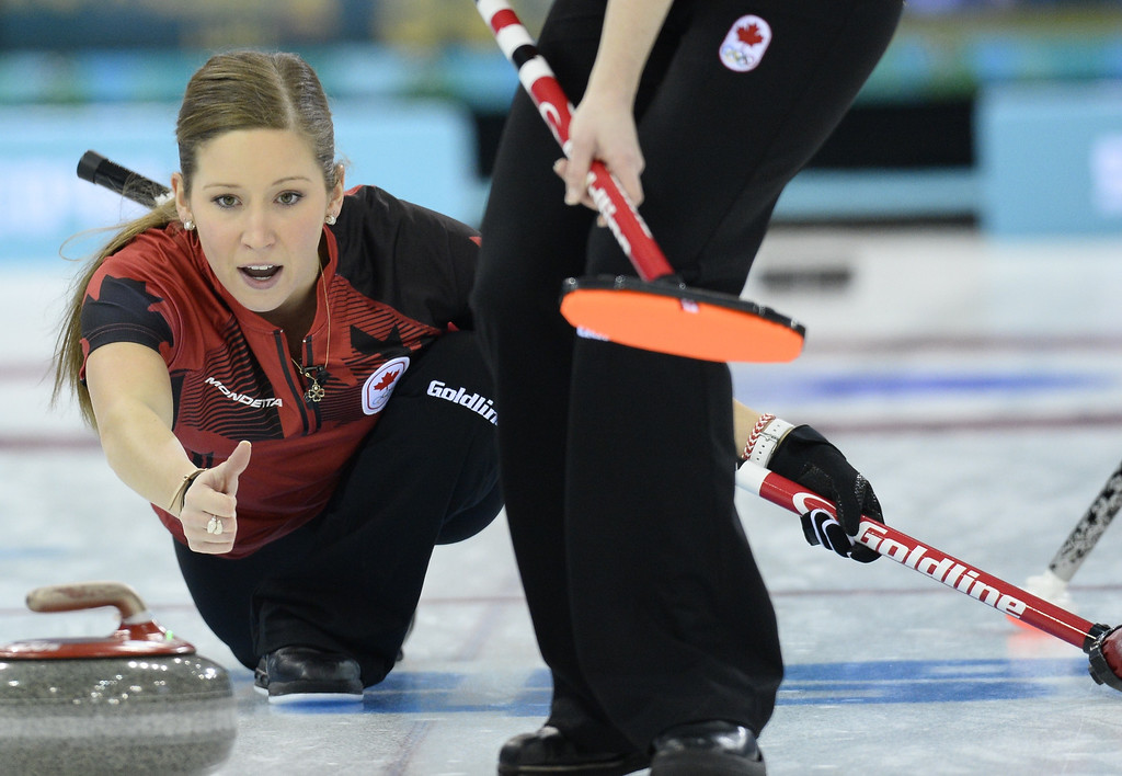 . Canada\'s Kaitlyn Lawes (C) throws a stone during the Women\'s Curling Round Robin Session 12 against South Korea at the Ice Cube Curling Center during the Sochi Winter Olympics on February 17, 2014.    JONATHAN NACKSTRAND/AFP/Getty Images