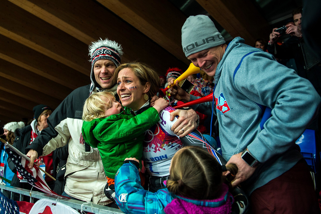 . KRASNAYA POLYANA, RUSSIA  - JANUARY 14: Noelle Pikus-Pace celebrates with her family; son Traycen, 2, daughter Lacee, 6, husband Janson, right, and her brother Jared Pikus, left, after winning the silver medal in the women\'s skeleton competition at Sanki Sliding Center during the 2014 Sochi Olympics Friday February 14, 2014. Pikus-Pace finished with a time of 3:53.86. (Photo by Chris Detrick/The Salt Lake Tribune)