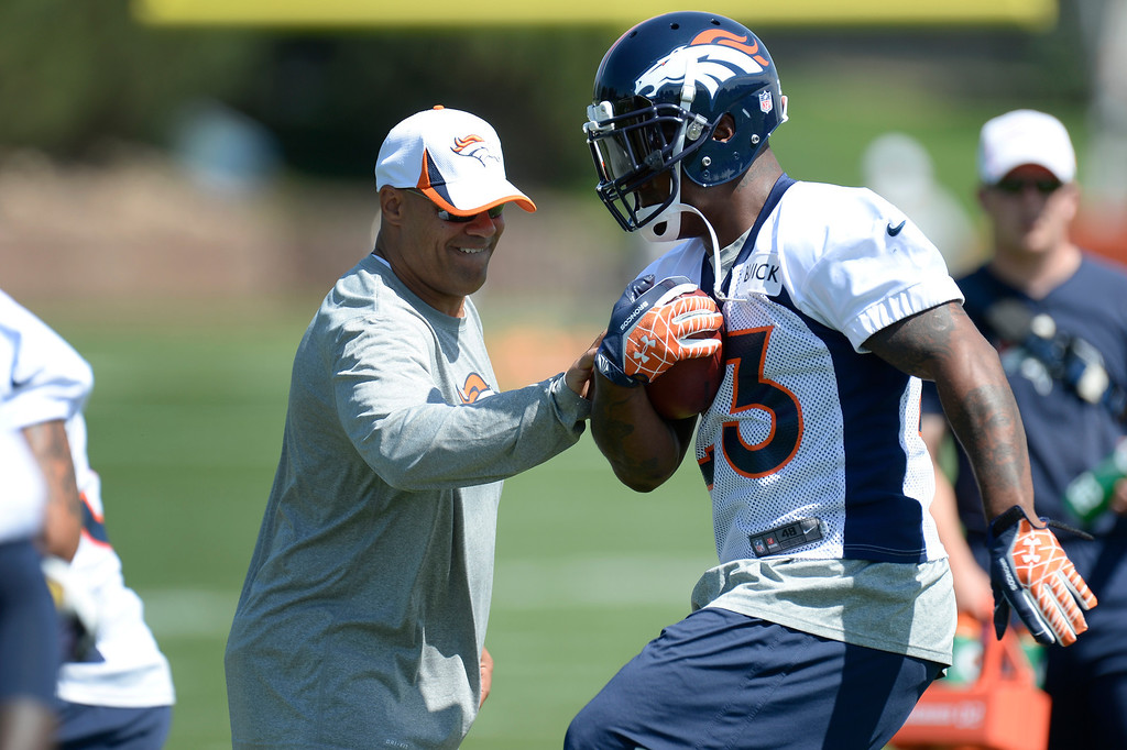 . Running back Willis McGahee of the Denver Broncos works on drills with Eric Studesville during mini camp June 11, 2013 at Dove Valley. (Photo By John Leyba/The Denver Post)