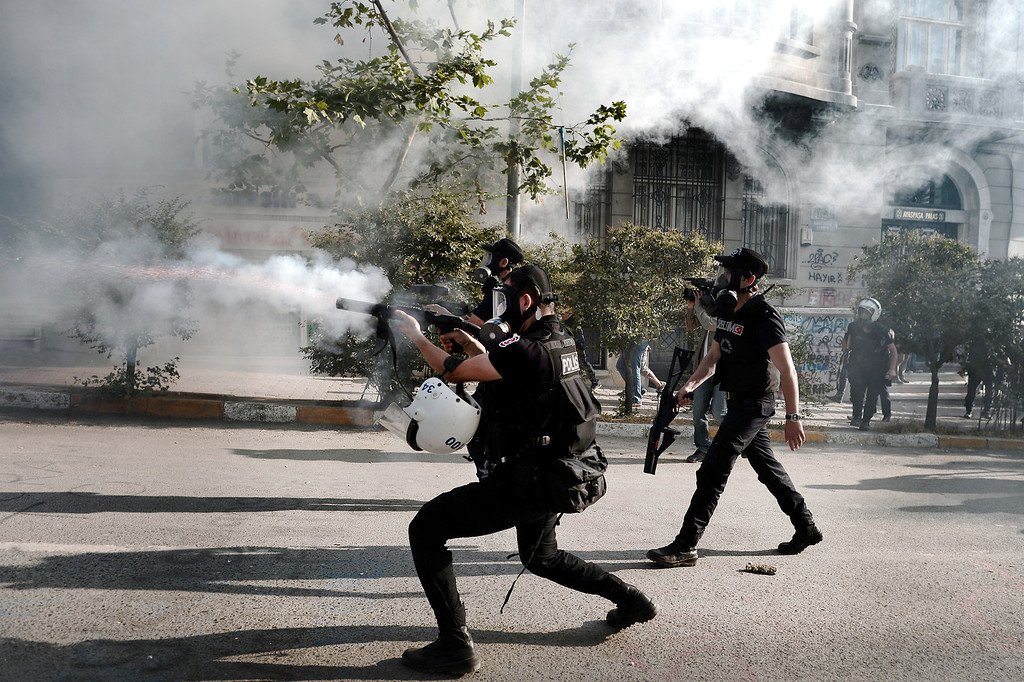. Riot police fire tear gas and rubber bullets to protesters at Istanbul\'s Taksim square, the epicenter of nearly two weeks of anti-government demos, during clashes with riot police on June 11, 2013 on a 12th day of unrest.     AFP PHOTO / ARIS MESSINIS/AFP/Getty Images