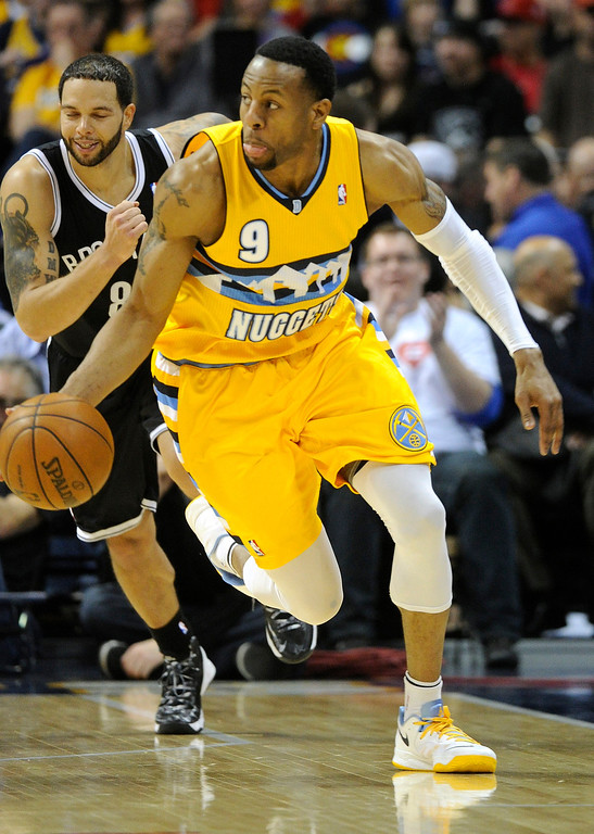 . DENVER, CO. - MARCH 29: Andre Iguodala (9) of the Denver Nuggets got out ahead of Deron Williams (8) of the Brooklyn Nets on a break in the first half. The Denver Nuggets hosted the Brooklyn Nets Friday night, March 29, 2013 at the Pepsi Center in Denver.  (Photo By Karl Gehring/The Denver Post)