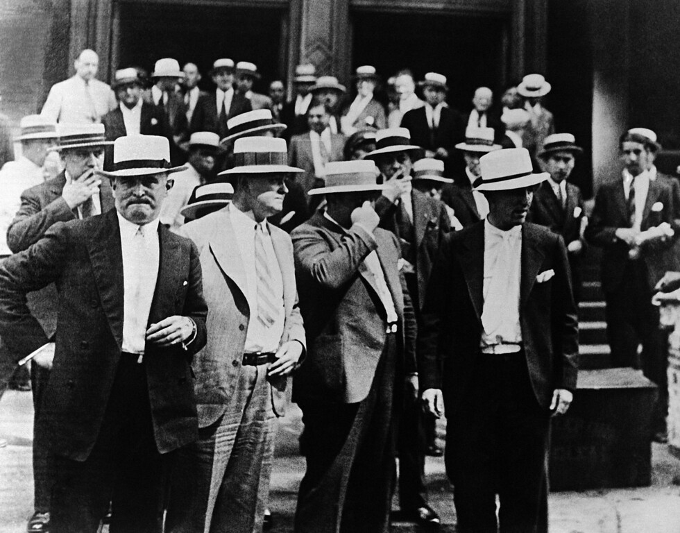 . Gangster Al Capone, surrounded by bodyguards whilst leaving the Federal Building in Chicago, USA around July 30, 1931, after his case had been adjoined until the afternoon session. Capone is charged with Income Tax evasion and conspiracy to violate the Prohibition Laws. (AP Photo)