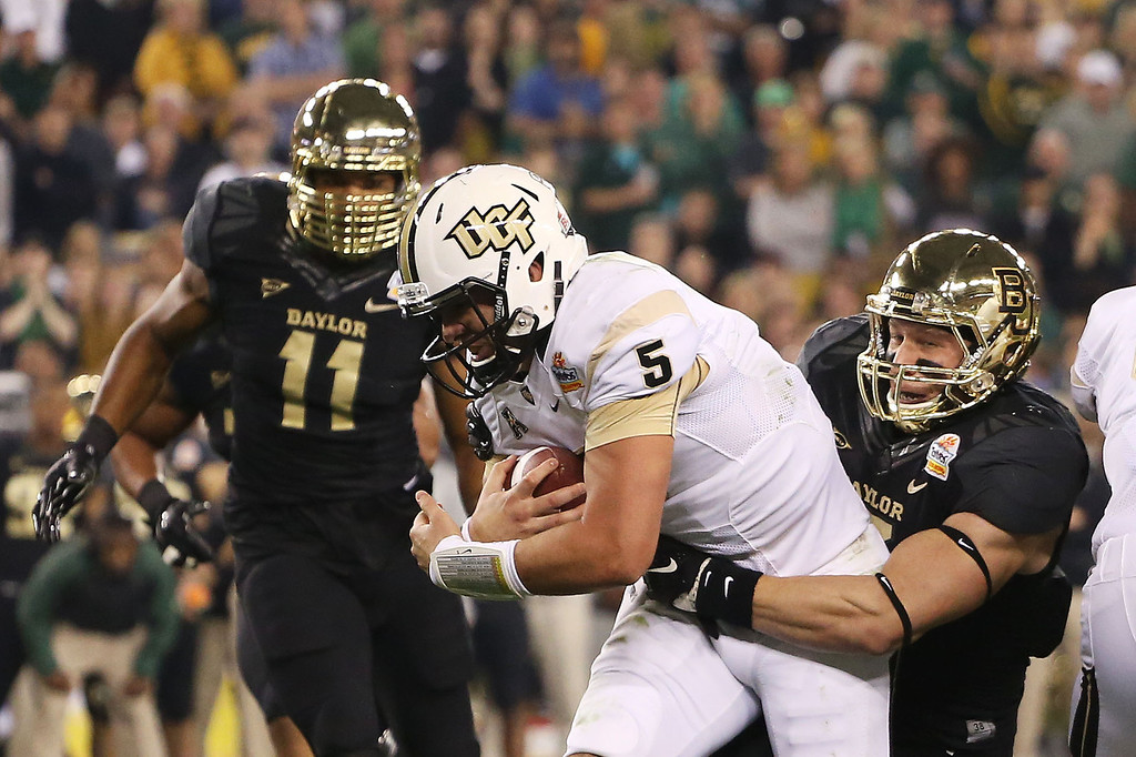 . GLENDALE, AZ - JANUARY 01:  Quarterback Blake Bortles #5 of the UCF Knights is tackled by Eddie Lackey #5 of the Baylor Bears in the first quarter during the Tostitos Fiesta Bowl at University of Phoenix Stadium on January 1, 2014 in Glendale, Arizona.  (Photo by Christian Petersen/Getty Images)