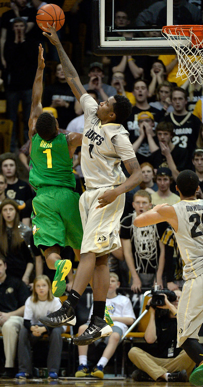 . Colorado Buffaloes forward Wesley Gordon (1) blocks a shot by Oregon Ducks guard Dominic Artis (1) late in the second half January 5, 2014 at Coors Events Center. Colorado Buffaloes defeated the Oregon Ducks 100-91. (Photo by John Leyba/The Denver Post)